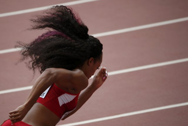 Natasha Hastings of U.S. competes in the women's 400 metres heats during the 15th IAAF World Championships at the National Stadium in Beijing, China August 24, 2015. (Photo by David Gray/Reuters)