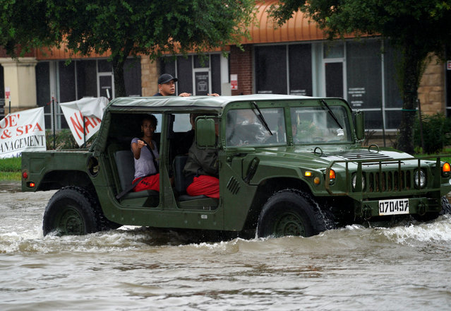 People are evacuated by a high water vehicle in Dickinson, Texas on August 28, 2017. (Photo by Rick Wilking/Reuters)