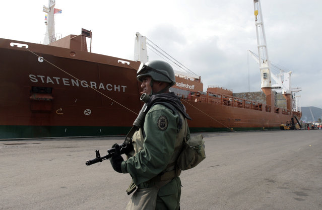 "In this March 21, 2009, file photo, a soldier patrols at the seaport in Puerto Cabello, Venezuela after late President Hugo Chavez ordered naval vessels and military personnel to seize control of two of Venezuela's largest seaports, Puerto Cabello and Maracaibo ports. President Nicolas Maduro promoted Defense Minister Gen. Vladimir Padrino on July 2016, to head what is called the Great Mission of Sovereign Supply. The goal is to boost production and guarantee the smooth distribution of food in the face of what Maduro sees as economic sabotage by his opponents. As part of the overhaul, all ministries will take orders from Padrino, and the nation's ports will fall under the ""total control"" of the military. (Photo by Howard Yanes/AP Photo)"