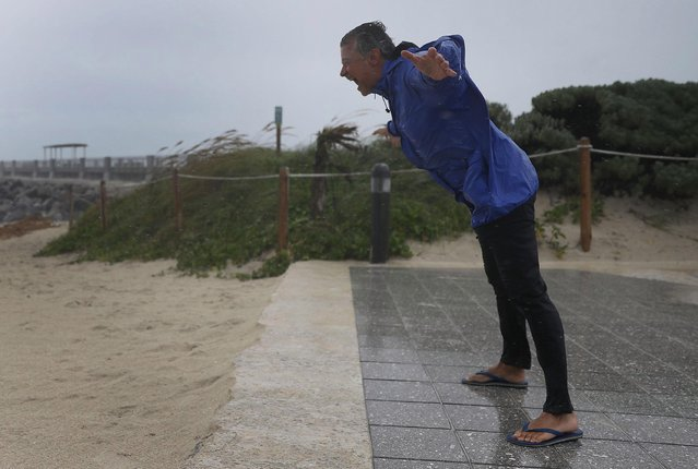 Arnold Naintre leans into the winds as Hurricane Irma approaches on September 9, 2017 in Miami Beach, Florida. Florida is in the path of the Hurricane which may come ashore at category 4. (Photo by Joe Raedle/Getty Images)
