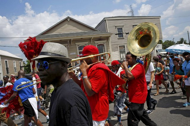The All For One brass band performs in a second-line parade marking the 10th anniversary of Hurricane Katrina on St. Claude Avenue in New Orleans, Louisiana August 29, 2015. (Photo by Edmund D. Fountain/Reuters)