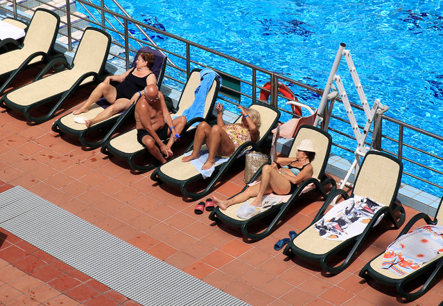 People sunbathe at the Lukacs Bath in Budapest, Hungary June 28, 2016. (Photo by Bernadett Szabo/Reuters)