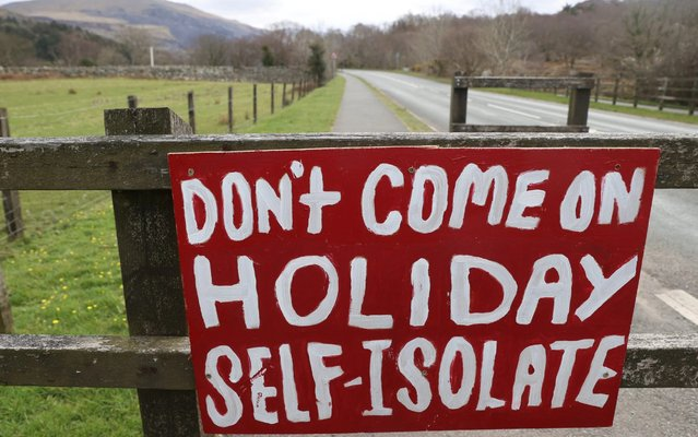 "A message reading ""Don't come on Holiday, Self Isolate"" is seen in Snowdonia as the spread of the coronavirus disease (COVID-19) continues, Llanberis, Wales, Britain, April 4, 2020. (Photo by Carl Recine/Reuters)"