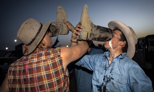 Participants drink out of their boots at the 2017 Deni Ute Muster on September 30, 2017 in Deniliquin, Australia. The annual Deniliquin Ute Muster is the largest ute muster in Australia, attracting more than 18,000 people to the rural town of Deniliquin together to celebrate all things Australian and the icon of the Ute in a weekend of music, competitions and camping. (Photo by Perry Duffin/AAP)