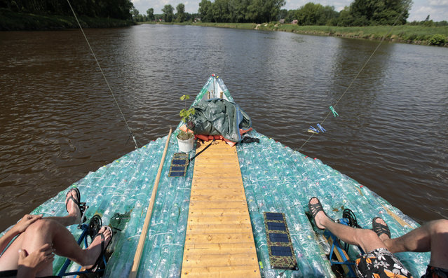 Jan Kara (R) and Jan Holan pedal their boat, made with plastic bottles, on the Elbe river near Kostelec nad Labem July 15, 2014. (Photo by David W. Cerny/Reuters)