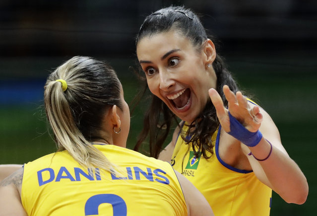 Brazil's Sheilla Castro de Paula Blassioli, right, reacts after a score in a women's quarterfinal volleyball match against China at the 2016 Summer Olympics in Rio de Janeiro, Brazil, Tuesday, August 16, 2016. (Photo by Robert F. Bukaty/AP Photo)