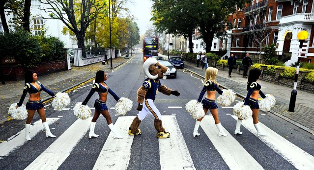 St. Louis Rams cheerleaders and their mascot Rampage pose for photographs on the Abbey Road zebra crossing made famous by the Beatles in London October 24, 2012. The Rams will play the New England Patriots at Wembley Stadium on Sunday, October28, in a regular season NFL game. (Photo by Dave Shopland/NFL)