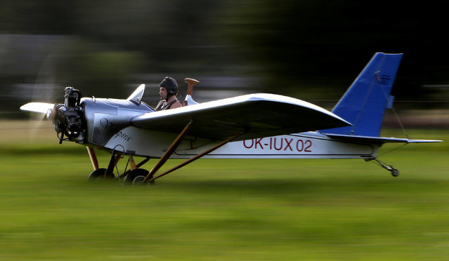 Aviator Frantisek Hadrava takes off with Vampira, an ultralight plane based on the U.S.-design of light planes called Mini-Max, near the village of Zdikov, Czech Republic, August 23, 2016. Frantisek thought driving to work for 14 minutes was too much, so he built an plane to cut the commute by half. Hadrava, a 45-year old locksmith from the south-western Czech village of Zdikov, took about two years of his spare time to built his Vampira, an ultralight plane based on the U.S.-design of light planes called Mini-Max. The plane has an open cockpit, propeller powered by a 3-cylinder engine made by Czech firm Verner, and maximum speed of 146 km (91 miles) an hour. It cost about 3,700 euros ($4,200) to build, Hadrava said. Photo by David W. Cerny/Reuters)