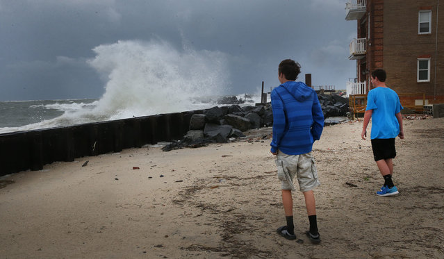 Brothers Joshua, 14, and Theodore Hensley, 12, of Taneytown Md., watch the surf pound the new bulkheads of the bay entrance at the end of Atlantic Avenue in the South Inlet area of Atlantic City, N.J., on Saturday, September 3, 2016. The approach of Tropical Storm Hermine forced both weekend beach concerts to be cancelled. (Photo by Ben Fogletto/The Press of Atlantic City)
