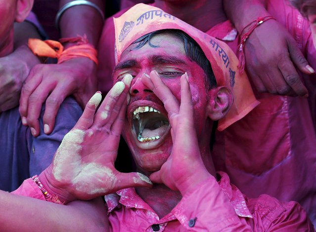 A devotee daubed in colour shouts religious slogans as he takes part in the immersion of an idol of the Hindu god Ganesh, the deity of prosperity, during the ten-day-long Ganesh Chaturthi festival in Ahmedabad, India, September 23, 2015. (Photo by Amit Dave/Reuters)