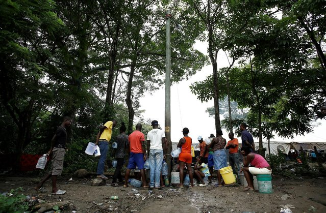 African migrants stranded in Costa Rica line up to collect water at a makeshift camp at the border between Costa Rica and Nicaragua, in Penas Blancas, Costa Rica, September 8, 2016. (Photo by Juan Carlos Ulate/Reuters)