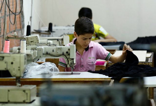 Muhamed, a Syrian refugee boy, works at a small textile factory in Istanbul, Turkey, June 24, 2016. (Photo by Murad Sezer/Reuters)