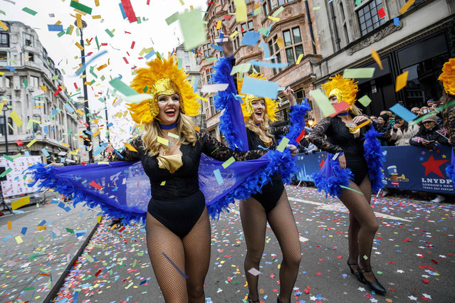 Participants take part in the annual New Year' s Day Parade in central London, United Kingdom on January 1, 2018. (Photo by Tolga Akmen/AFP Photo)
