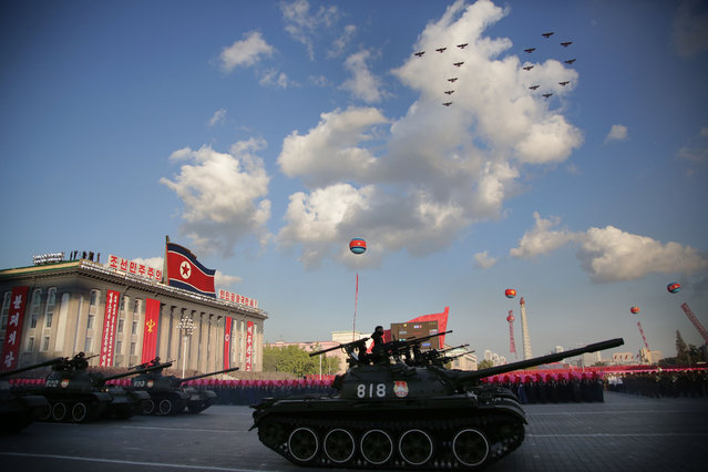 North Korean soldiers parade through Kim Il Sung Square with their missiles and rockets as jets fly in formation during a mass military parade, Saturday, October 10, 2015, in Pyongyang, North Korea. (Photo by Wong Maye-E/AP Photo)