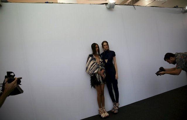 Models pose for photographers backstage before the PatBo Winter 2016 RTW collection during Sao Paulo Fashion Week October 20, 2015. (Photo by Nacho Doce/Reuters)