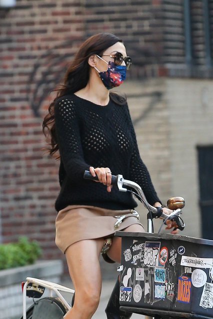 Former fashion model Famke Janssen looks fashionable on a bike ride in New York City on October 9, 2020. The 55 year old Dutch actress wore a face mask, dark shades, a black sweater paired with a tan skirt and knee high black boots. (Photo by TheImageDirect.com)