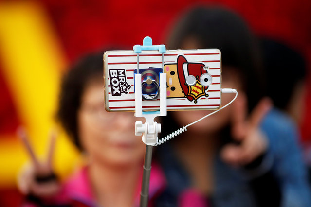 People take pictures of themselves in Tiananmen Square as they celebrate National Day marking the 67th anniversary of the founding of the People's Republic of China, in Beijing October 1, 2016. (Photo by Damir Sagolj/Reuters)