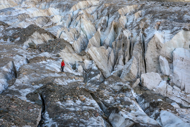 A nature lover takes a walk around the glaciers at Mountains Cilo, foothills of Uludoruk with a height of 4,135, in Yuksekova district of Hakkari, Turkey on October 14, 2020. Mountains Cilo was declared national park and this was launched with the aim of promoting the regions and revitalizing tourism, by establishing an atmosphere of trust. (Photo by Ozkan Bilgin/Anadolu Agency via Getty Images)