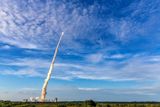 The Ariane 5 rocket lifts off from the Ariane Launchpad Area at the European Spaceport in Kourou, French Guiana, on October 5, 2016. The rocket successfully launched a pair of communications satellites, the australian SKY Muster II and the indian GSAT-18. (Photo by  Jody Amiet/AFP Photo)