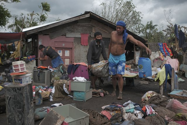 Residents try to save what's left of their belongings after heavy rains from Typhoon Goni washed down boulders and mudflows from Mayon Volcano, engulfing about 150 houses in a single community in the town of Guinobatan, Albay province, central Philippines on Monday, November 2, 2020. More than a dozen of people were killed as Typhoon Goni lashed the Philippines over the weekend, and about 13,000 shanties and houses were damaged or swept away in the eastern island province that was first hit by the ferocious storm, officials said Monday. (Photo by John Michael Magdasoc/AP Photo)