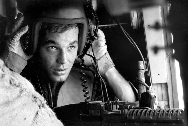 Lance Cpl. James C. Farley, helicopter crew chief, Vietnam, 1965. (Photo by Larry Burrows/Time & Life Pictures)