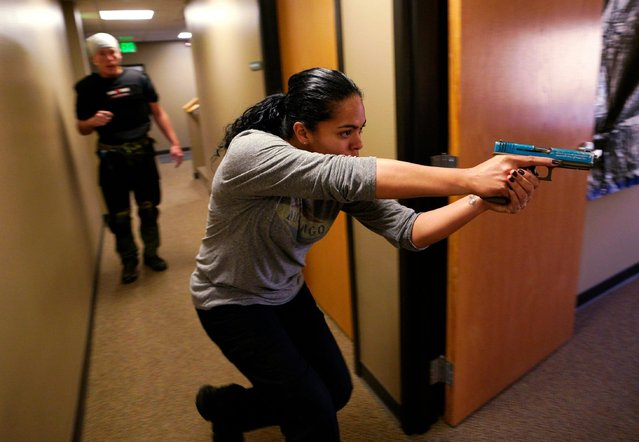 """Nicole Layog, former Broward County Sheriff Deputy, runs through a scenario in a """"Lone Wolf"""" civilian active shooter response course for concealed weapons permit holders on March 24, 2018 in Longmont, Colorado. Broward County was the site of the Stoneman Douglas High School shooting. The class, based on a similar law enforcement course, is designed to challenge students mentally and physically leaving with a solid plan to defend themselves and others during the critical first moments of a deadly attack. (Photo by Rick T. Wilking/Getty Images)"""