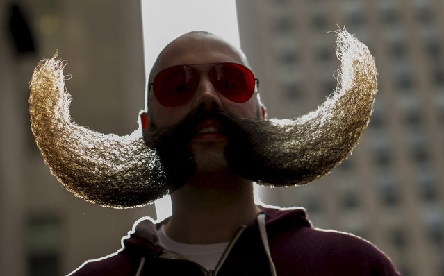 MJ Johnson gathers with other contestants  to promote the National Beard and Moustache Championships in New York November 6, 2015. The National Beard and Moustache Championships will take place on November 7, 2015 in Brooklyn, New York and will feature contestants from all over the world. (Photo by Brendan McDermid/Reuters)