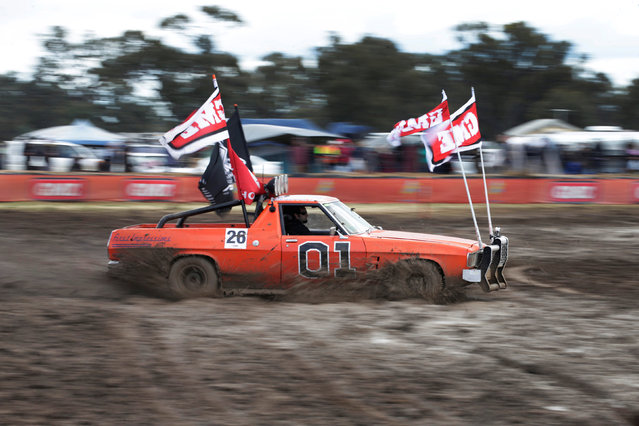 """Robert Dowse, 35, from Frankston in the Australian state of Victoria  powers his Australian """"ute"""" he calls """"General Lee"""" through thick mud during a """"circle work"""" competition of vehicle handling skills at the Deni Ute Muster in Deniliquin, New South Wales, September 30, 2016. (Photo by Jason Reed/Reuters)"""