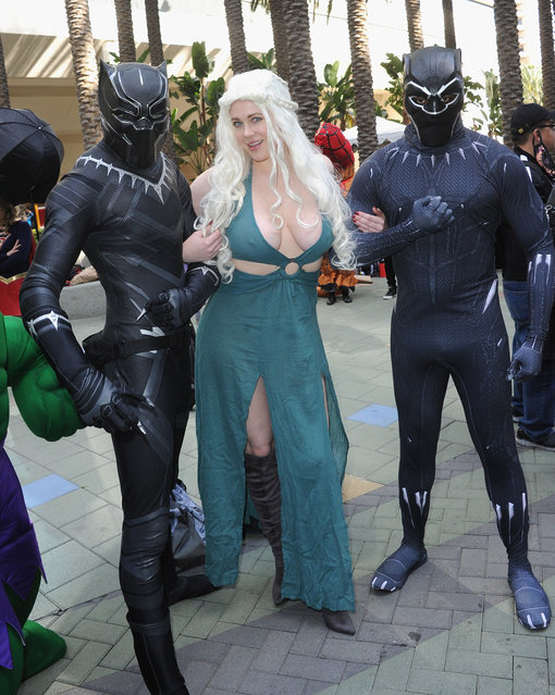 Actress Maitland Ward poses with a pair of Black Panthers on day 3 of WonderCon 2018 held at Anaheim Convention Center on March 25, 2018 in Anaheim, California. (Photo by Albert L. Ortega/Getty Images)