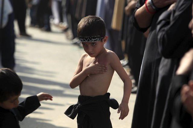 A Pakistani Shi'ite Muslim boy beats his chest while taking part in a Muharram procession ahead of Ashura in Islamabad, Pakistan, October 23, 2015. (Photo by Faisal Mahmood/Reuters)