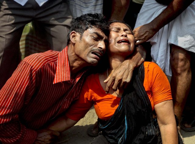 Relatives mourn at the scene of the collapse on Wednesday. (Photo by A. M. Ahad/Associated Press)