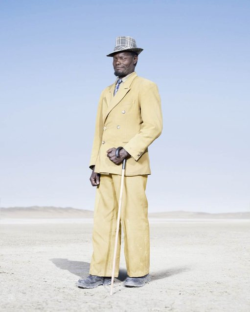 The tradition of wearing formal attire is maintained by most Herero elders, such as this man in a yellow double-breasted suit and check trilby. It is, however, noticeably in decline among younger Herero man, who tend to favor jeans and a t-shirt. (Photo by Jim Naughten, courtesy of Klompching Gallery, New York)