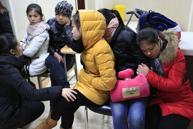 Relatives wait at a hospital where people injured in a stampede are being treated in Shanghai January 1, 2015. (Photo by Aly Song/Reuters)