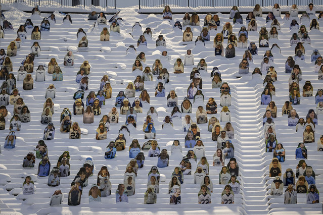 A general view of fan cutouts covered in snow before the game between the Penn State Nittany Lions and the Illinois Fighting Illini at Beaver Stadium on December 19, 2020 in State College, Pennsylvania. Fans were not permitted to attend the game due to the novel coronavirus (COVID-19) pandemic. (Photo by Scott Taetsch/Getty Images)