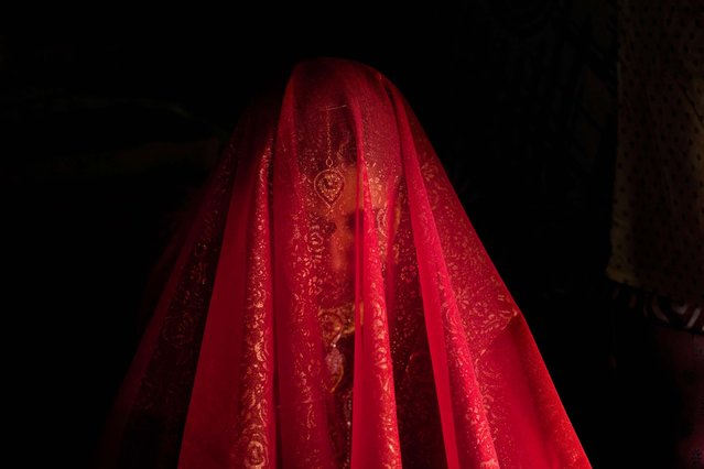 Zareena, a Kashmiri Bakarwal bride, sits inside a temporary camp during her wedding ceremony on the outskirts of Srinagar, India, on May 31, 2013. (Photo by Dar Yasin/Associated Press)