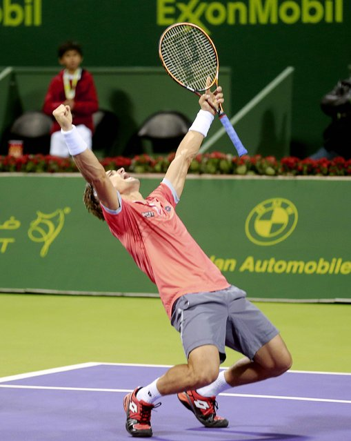 David Ferrer of Spain celebrates after winning his semi-final match against Croatia's Ivo Karlovic at the Qatar Open tennis tournament in Doha January 9, 2015. (Photo by Mohammed Dabbous/Reuters)