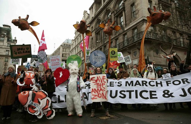 Protesters demonstrate during a rally held the day before the start of the Paris Climate Change Summit, in London, Britain November 29, 2015. (Photo by Suzanne Plunkett/Reuters)