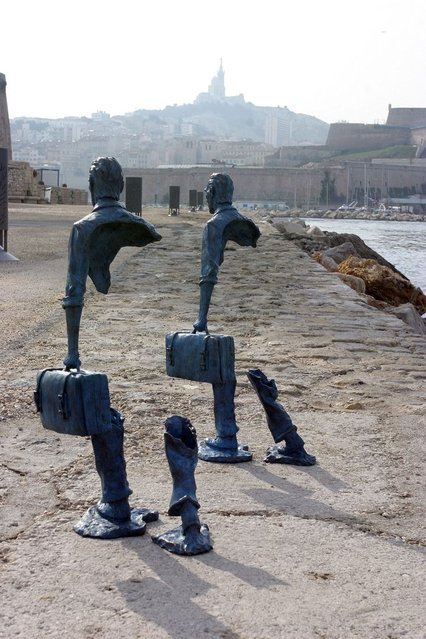 Two sculputures at the waterfront in Marseille – Ever feel like youve forgotten something? No its not a mind trick – these are the amazing photos of sculptures done by a French artist. The sculptures are the work of Bruno Catalano and might look like theyre missing vital organs but the invisible bodies represent a world citizen according to their creator. (Photo by Caters News Agency)