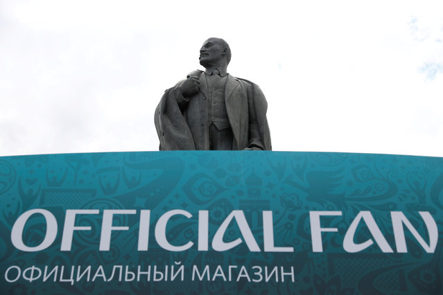 A Statue of Vladimir Lenin is pictured outside the Luzhniki Stadium in Moscow ahead of the World Cup on June 14, 2018. (Photo by Kai Pfaffenbach/Reuters)