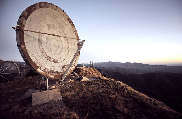 """Ice Station Zebra"". Two giant dishes sit abandoned overlooking the vast Italian mountain tops. It was once part of the ACE High project, a NATO communications system which dates back to 1956. The system was decommissioned in the late 1980s. (Photo and caption by Reginald Van de Velde/National Geographic Traveler Photo Contest)"
