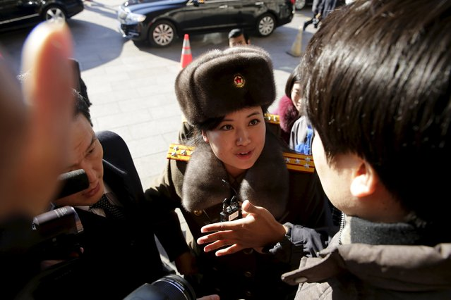 A member of the Moranbong Band from North Korea speaks to the press outside a hotel in central Beijing, China, December 11, 2015. North Korea's State Merited Chorus and the Moranbong Band will perform at the National Grand Theatre in Beijing from Saturday to Monday, Xinhua News Agency reported. (Photo by Reuters/Stringer)