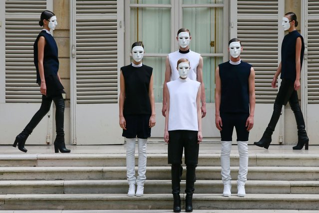 Models present creations by Jordan-born designer Rad Hourani as part of his Haute Couture Fall Winter 2013/2014 fashion show in Paris, on July 5, 2013. (Photo by Gonzalo Fuentes/Reuters)