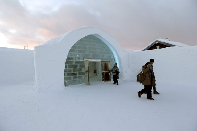 People leave Ice hotel in Jukkasjarvi, Sweden, December 16, 2015. (Photo by Ints Kalnins/Reuters)