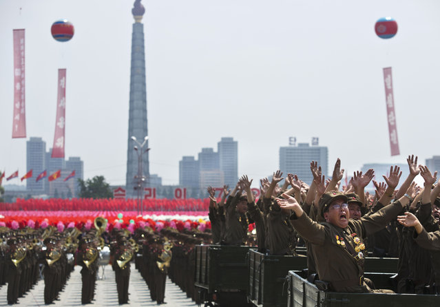 North Korean military veterans wave to their leader Kim Jong Un during a mass military parade on Kim Il Sung Square in Pyongyang to mark the 60th anniversary of the Korean War armistice Saturday, July 27, 2013. (Photo by David Guttenfelder/AP Photo)