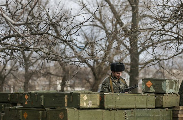A member of a rebel unit of the self-proclaimed separatist Donetsk People's Republic guards the village of Olenivka, south of Donetsk, February 7, 2015. (Photo by Maxim Shemetov/Reuters)