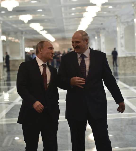 Russia's President Vladimir Putin (L) talks to Belarus' President Alexander Lukashenko before a meeting on resolving the Ukrainian crisis in Minsk, February 11, 2015. (Photo by Mykola Lazarenko/Reuters)