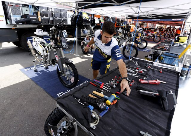 A mechanic of the Husqvarna Racing Team works in the team's box ahead of the Dakar Rally 2016 in Buenos Aires, Argentina, December 31, 2015. (Photo by Marcos Brindicci/Reuters)