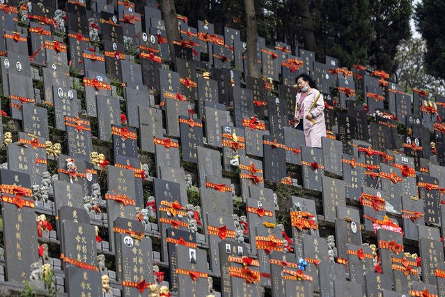 People sweep tombs during Qingming Festival on April 3, 2021 in Wuhan, Hubei province, China. Wuhan implemented a 76 day lockdown from January 23rd to April 8th.2020.because the local government strictly defends the Covid-19 Wuhan With no recorded cases of community transmissions since May 2020, life for residents is gradually returning to normal.(Photo by Getty Images)