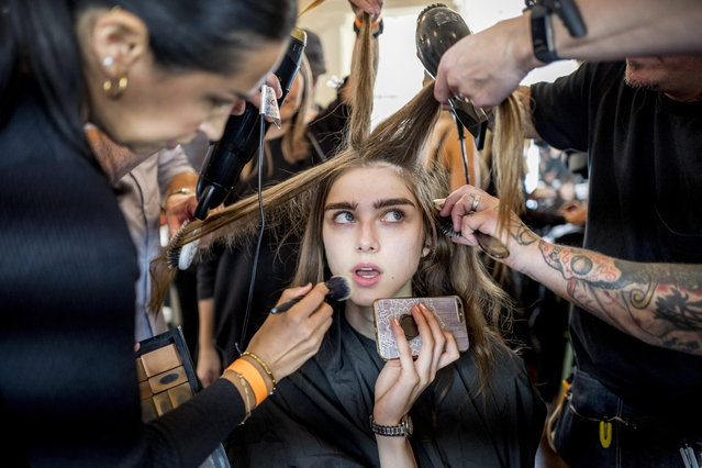 A model has her hair and make-up done backstage ahead of a show of British designer Jasper Conran at the London Fashion Week, in London, Britain, 15 September 2018. (Photo by Tolga Akmen/EPA/EFE)