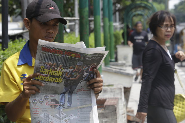 A man reads a newspaper with a front page story about Thursday's attacks at the Starbucks cafe in Jakarta, Indonesia, Friday, January 15, 2016. (Photo by Tatan Syuflana/AP Photo)